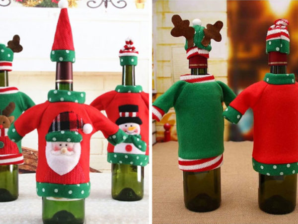 £2.99 instead of £9.99 (from MBLogic) for a Christmas jumper wine bottle cover - choose from three designs and save 70%