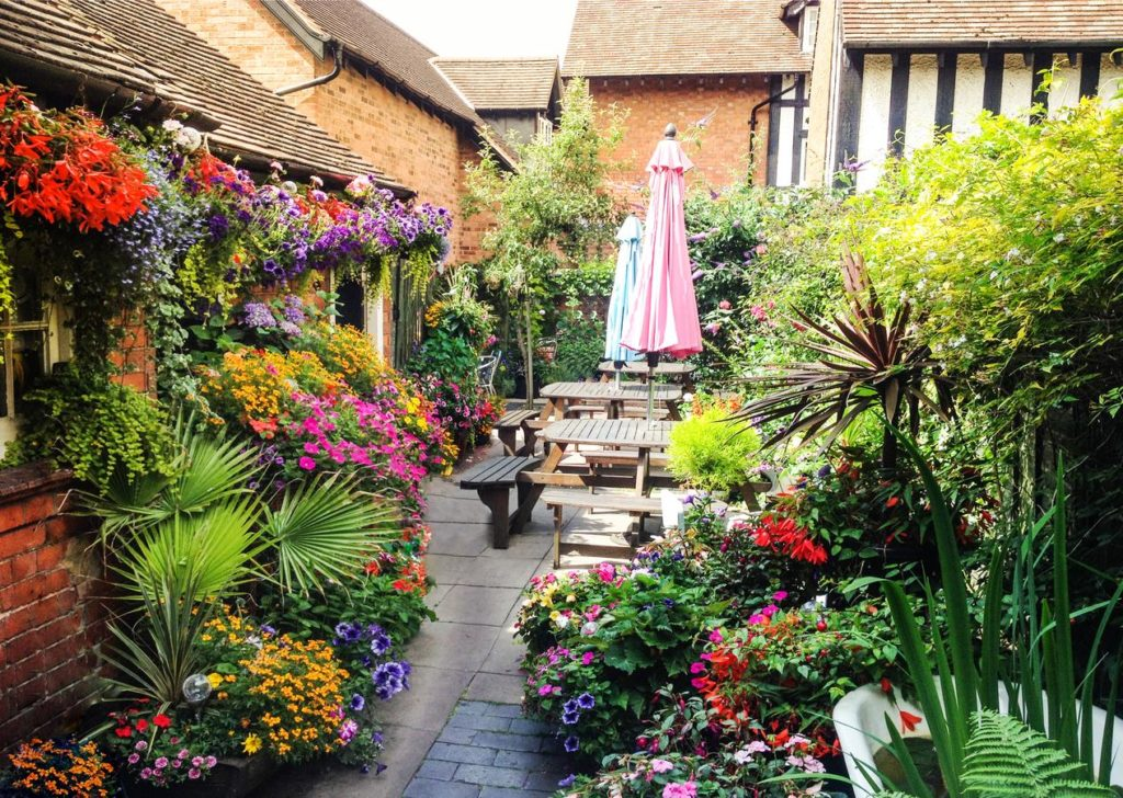 Flowers galore and picnic tables at kid-friendly Bournville Bed and Breakfast mini-garden