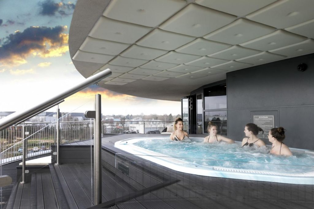 4 women enjoying a hot tube overlooking the city, perfect for families and group of friends at Brooklands Hotel & Spa