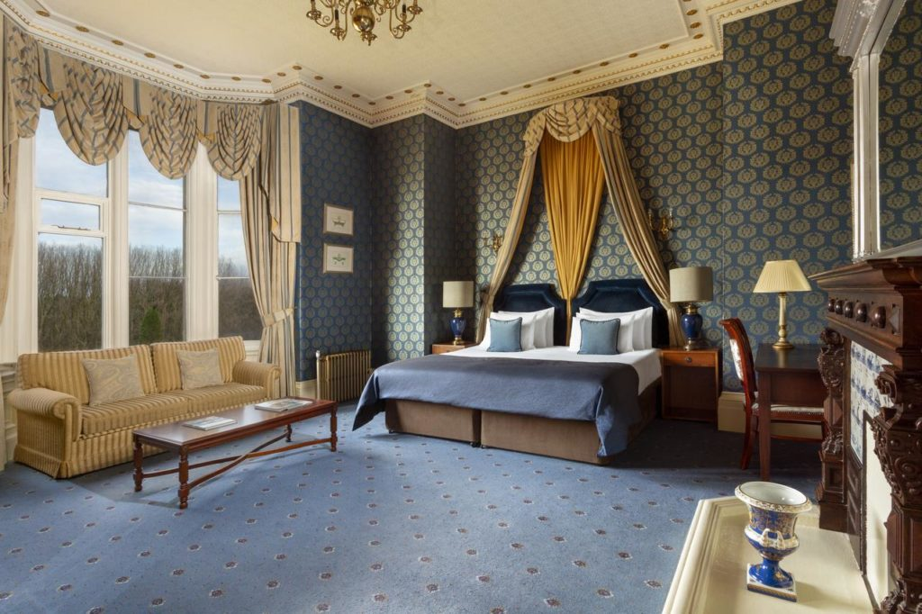 Inside a spacious family-friendly Quad Room with double sofa bed at Crewe Hall