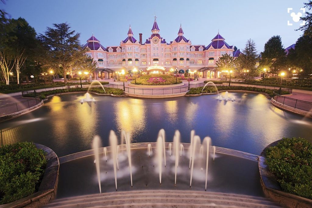 Enchanting fountains & beautiful exterior of kid-friendly Disneyland Hotel found inside DIsneyland Paris