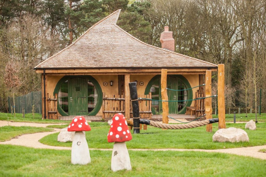 Exterior view of one of Enchanted Village Woodland lodges