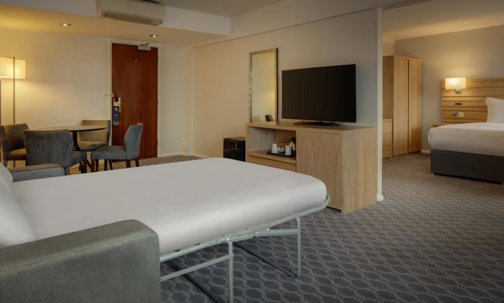 Inside a conjoining room with sofa bed, sleeps 4 at family-friendly Hilton London Watford