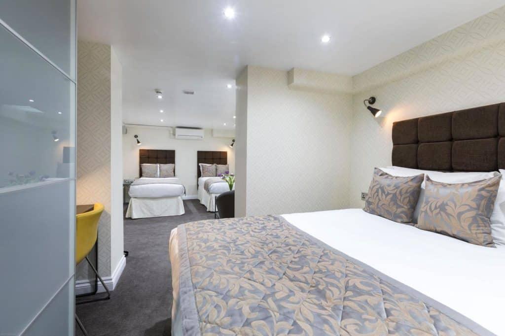 Inside interconnected family rooms of Hotel Shepherds Bush London