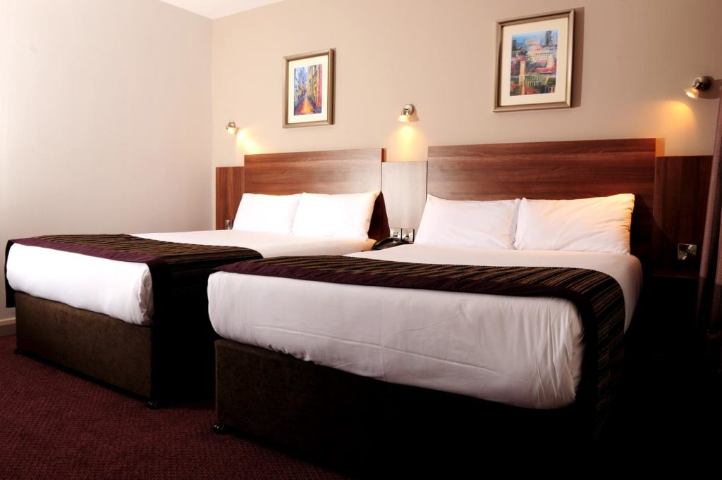 Inside a family room with two double beds at kid-friendly Jurys Inn Birmingham