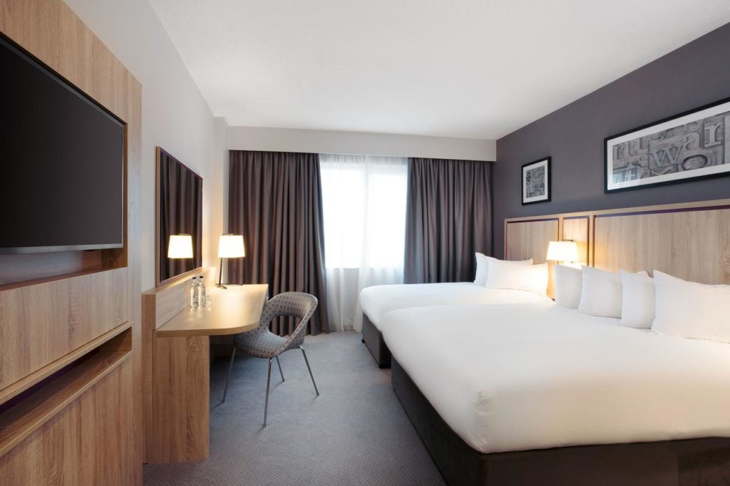 Inside a family room with 2 beds that sleeps 4 at Jurys Inn London Watford near Harry Potter World
