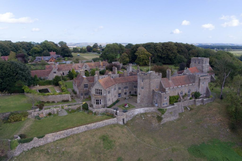 Aerial view of castle-like family-friendly Lympne Castle Cottages near Port Lympne