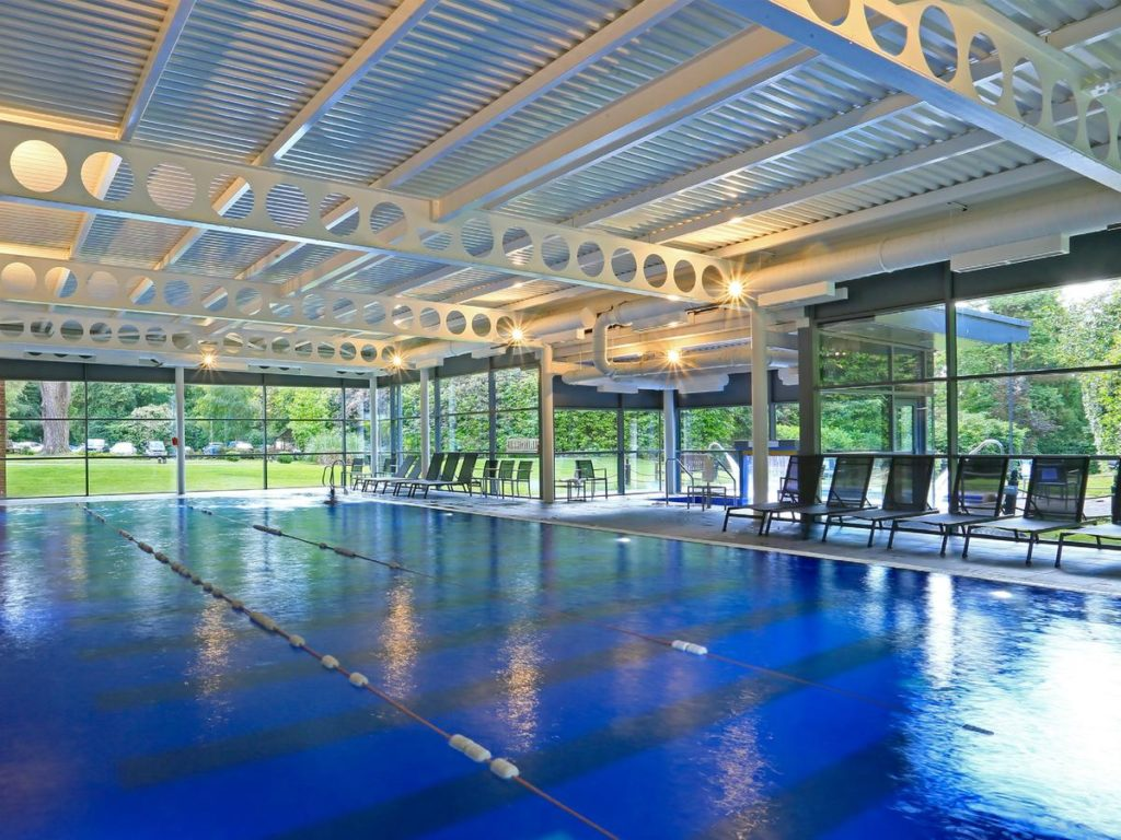 Covered outdoor long swimming pool perfect for family activities at French-chateau styled Macdonald Berystede Hotel & Spa