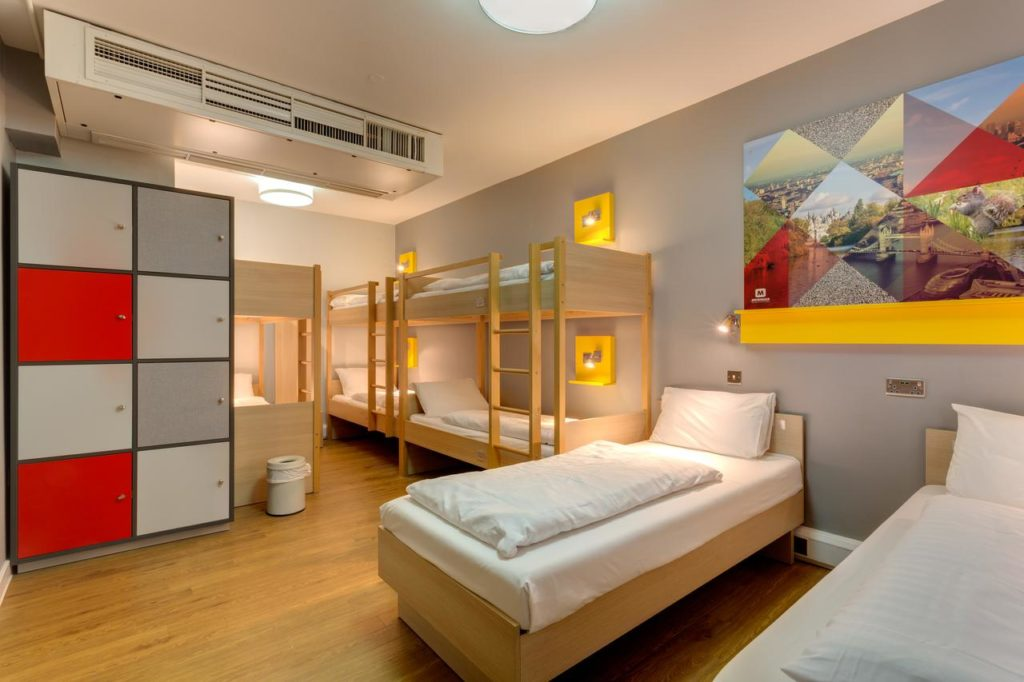 Family room that sleeps 8 with 3 bunkbeds and 2 single beds with personal cabinets at Meininger Hotel London Hyde Park