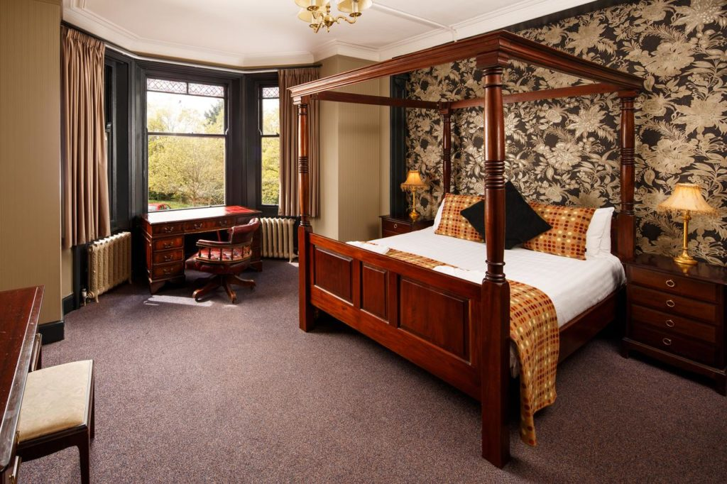 Inside a room with four-poster bed at a kid-friendly hotel, Mercure Bewdley The Heath Hotel