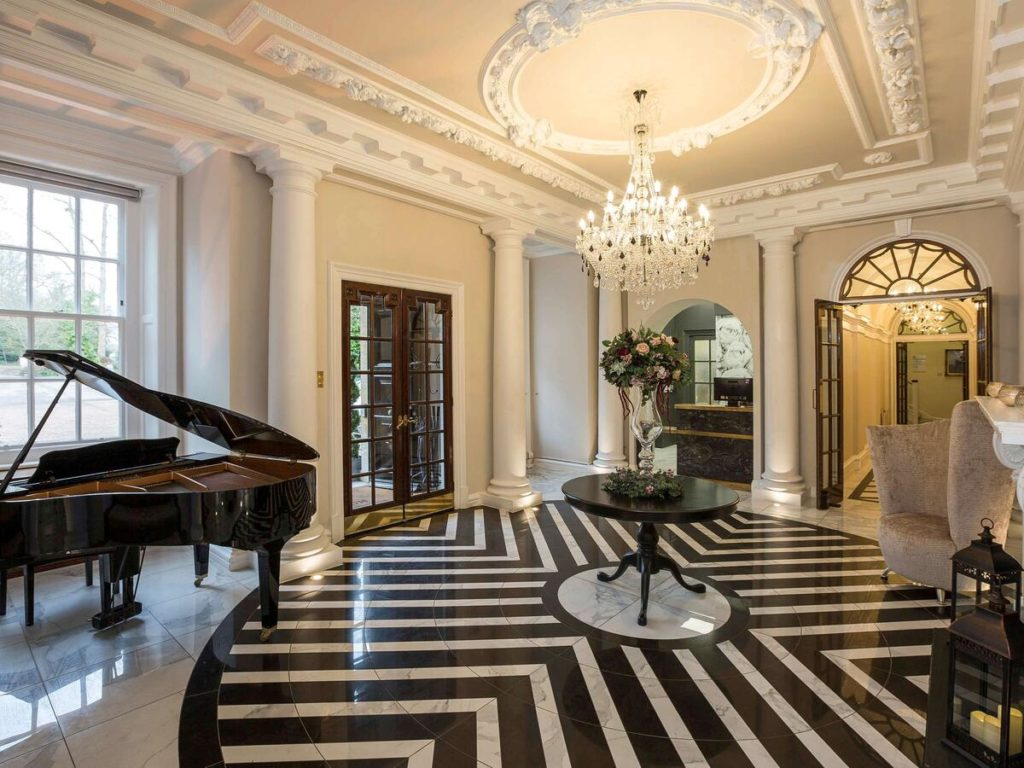 Grand piano and chandeliers make Mercure London North Watford Hunton Park one of the most elegant family-friendly hotel near Harry Potter World