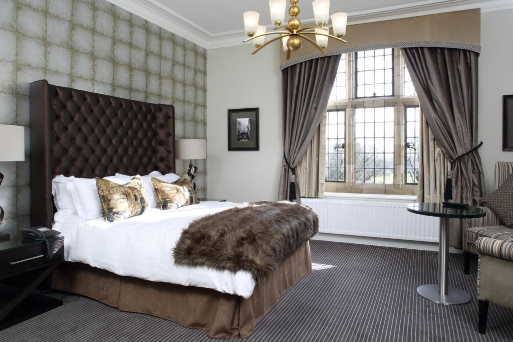 Inside a spacious family room at family-friendly boutique hotel at Moxhull Hall