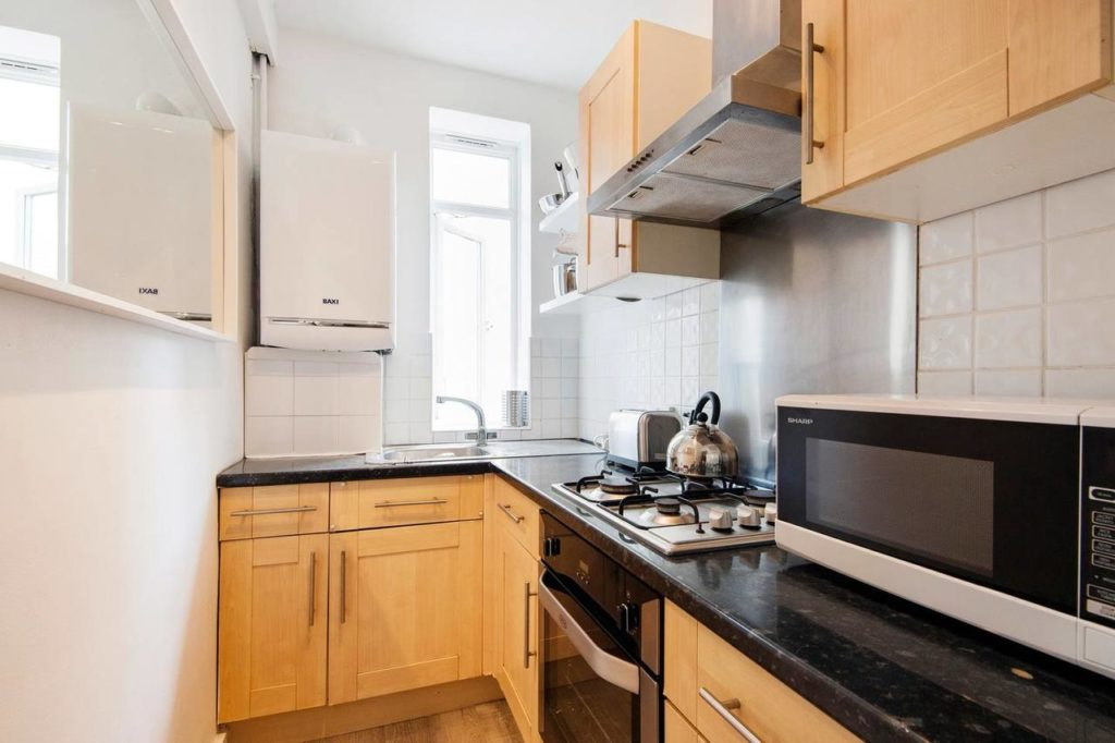 A view of the kitchen of a family apartment that sleeps 6 people at Notting Hill Flat near Portobello Road