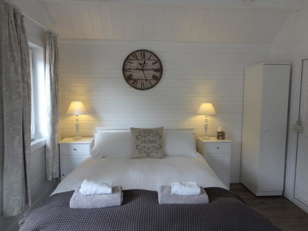 A comfortable double bed inside kid-friendly Park Farm's family room that sleeps 3