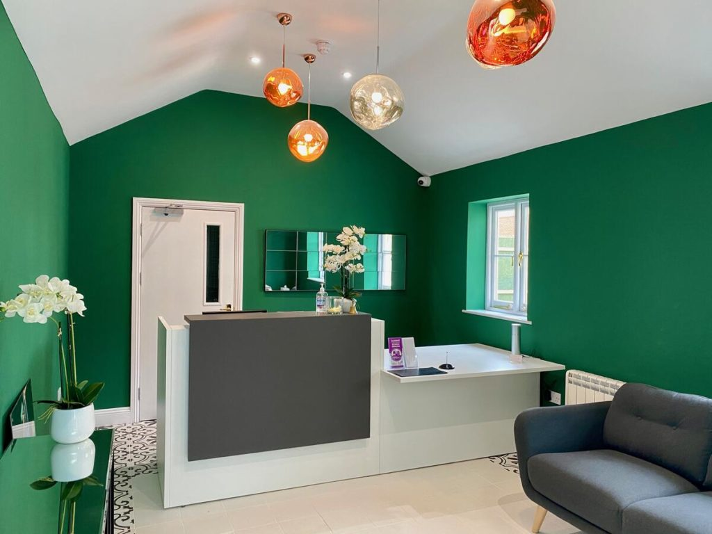 Green-themed living room with quirky lights at kid-friendly Peartree Serviced Apartments