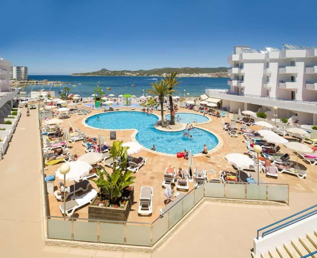 top view swimming pool and ocean at playa bella apartments