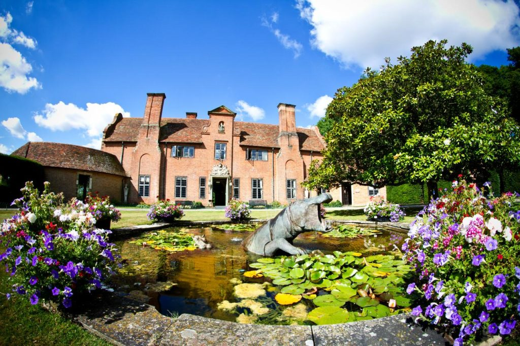 Exterior of kid-friendly Port Lympne Hotel & Reserve with pond and flowers