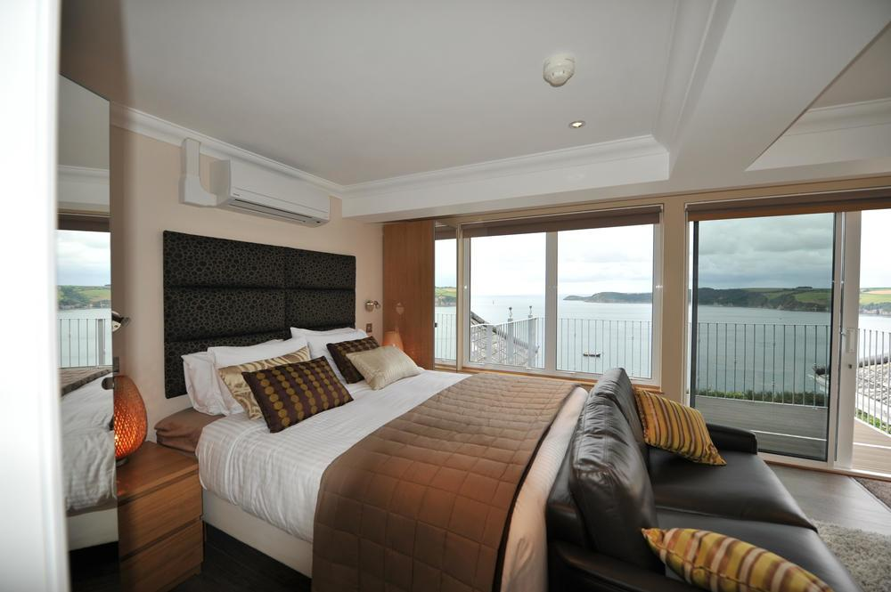 Inside a family room of Porth Avallen Hotel overlooking the sea viewoverCarlyon Bay