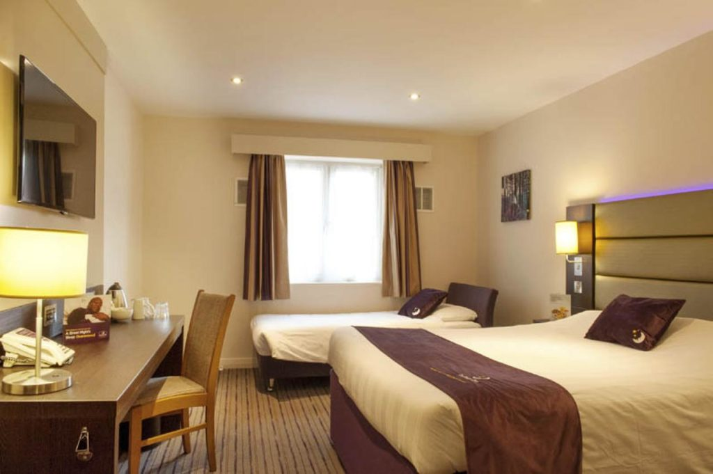 Inside a family room that sleeps 3, with extra bed at Premier Inn Southampton West