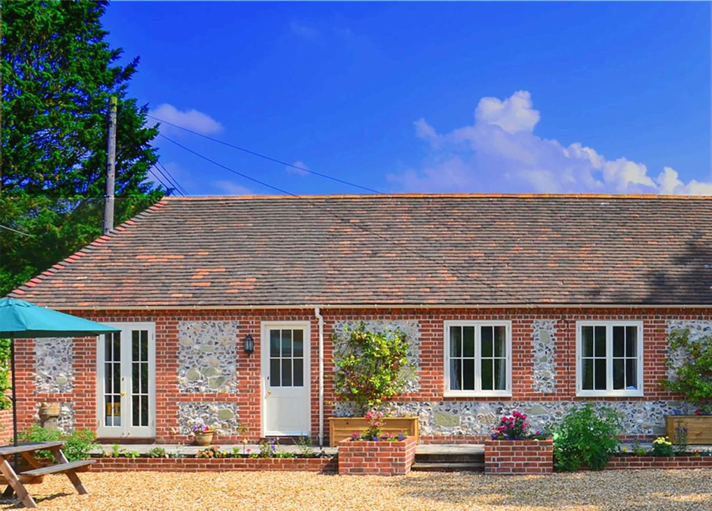 Exterior view of a 3-bedroom family cottage at Stonehenge Cottages