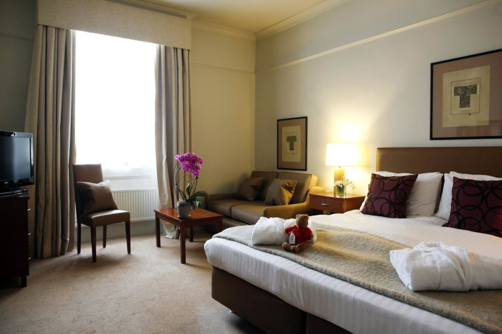 Old charm of a beautiful family room with a teddy bear inside kid-friendly Christopher Hotel
