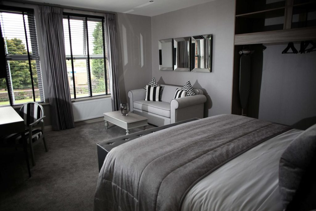 Gray-themed room at the family-friendly boutique hotel, The Eccleston Arms near Knowsley Safari Park