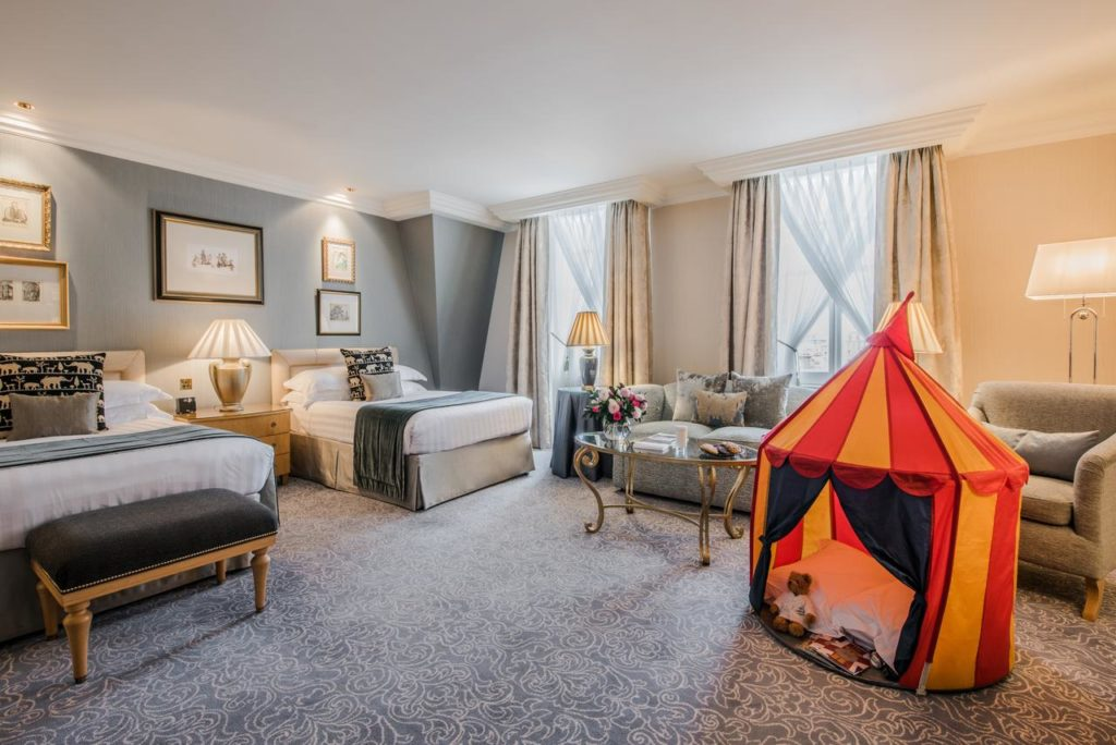 Inside a family room with kid's tent at The Landmark London