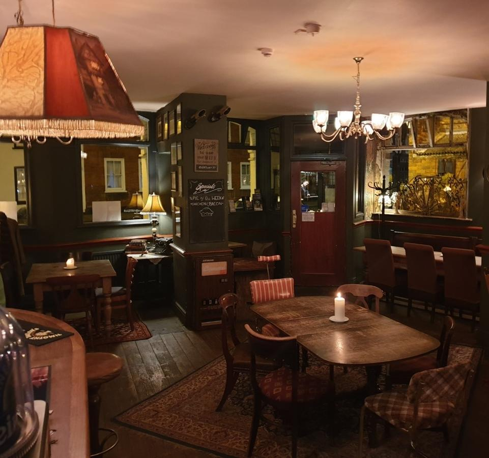 Dining area that gives off a classic era vibe at family-friendly The Olde Swan Hotel near Thorpe Park