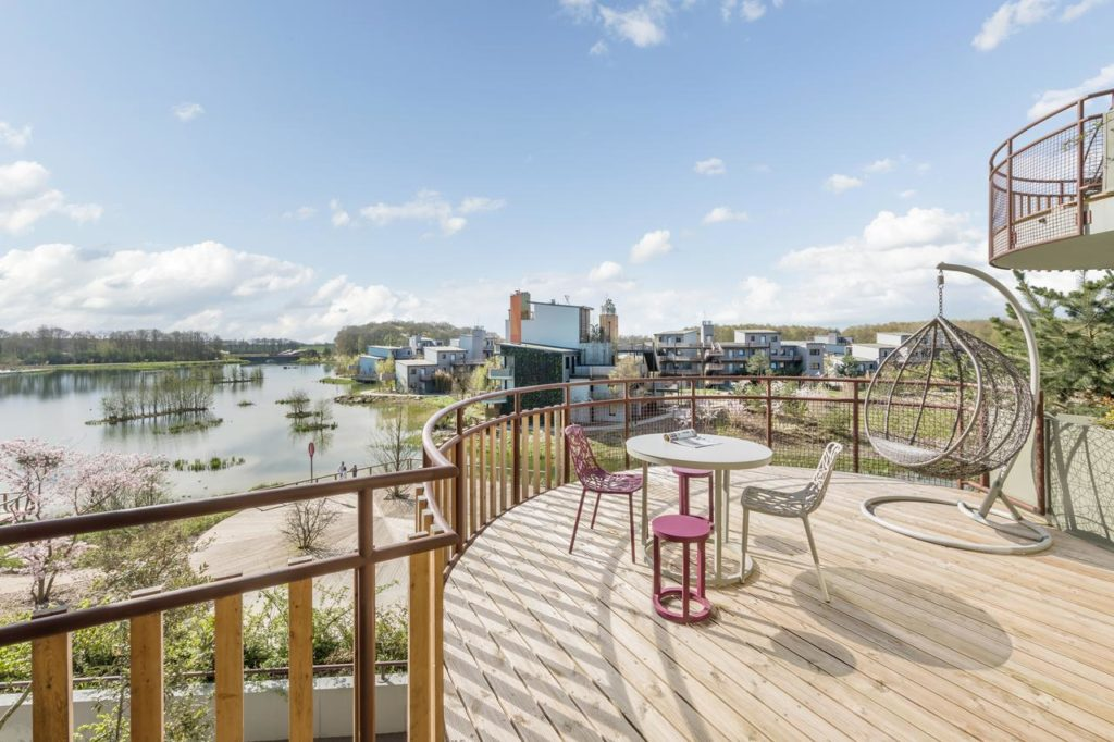 Awesome view with hanging egg chair at family-friendly Les Villages Nature Paris at Disneyland Paris