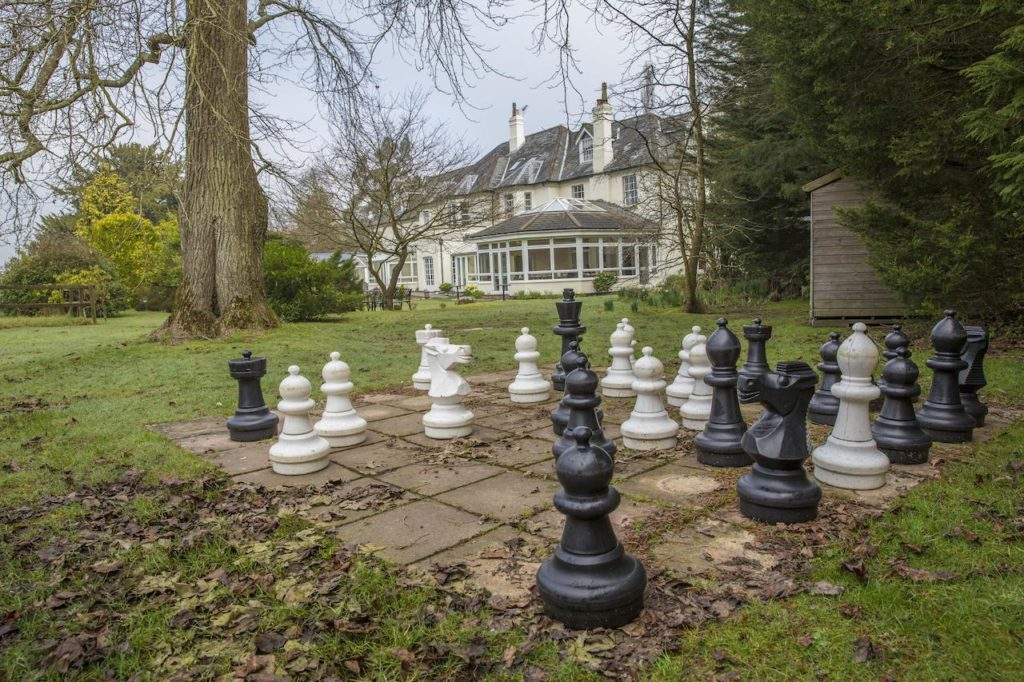 Giant Chess family activity located at Woodlands Lodge Hotel's garden
