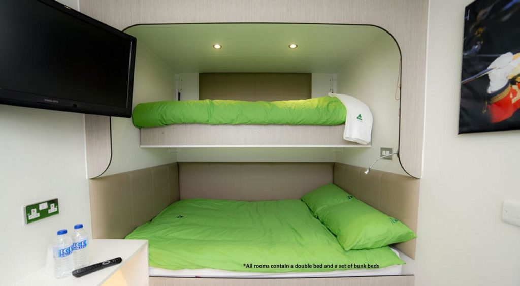 Quirky, Unique White & Green Family-friendly Sleeping pods made from repurposed shipping containers at YHA Eden Project