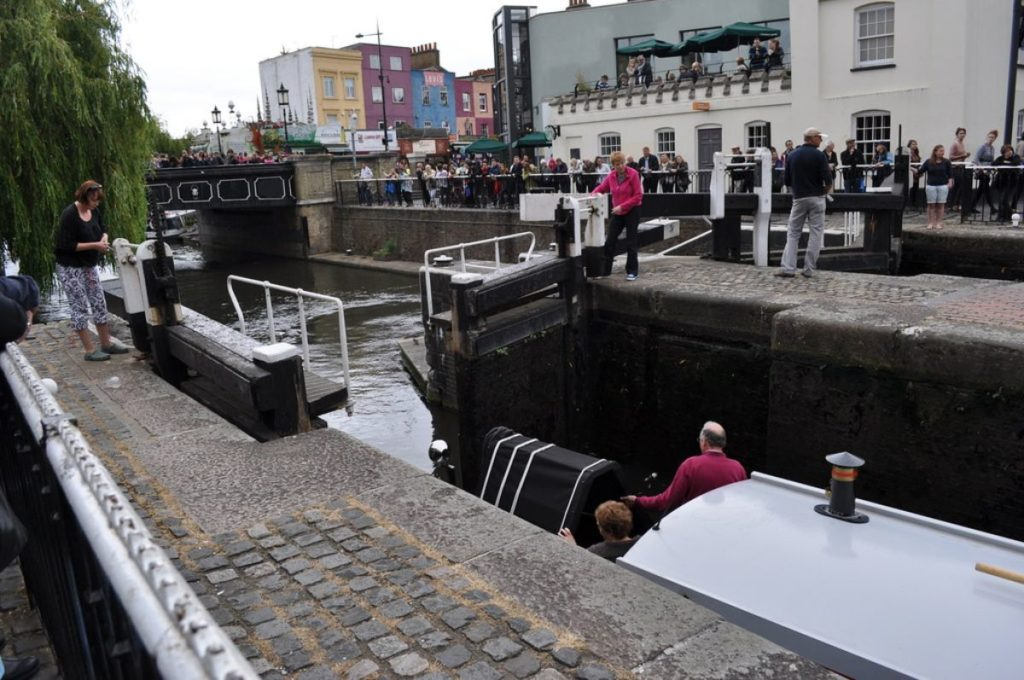 canal locks being opened to let a boat pass at family-friendly camden locks and market