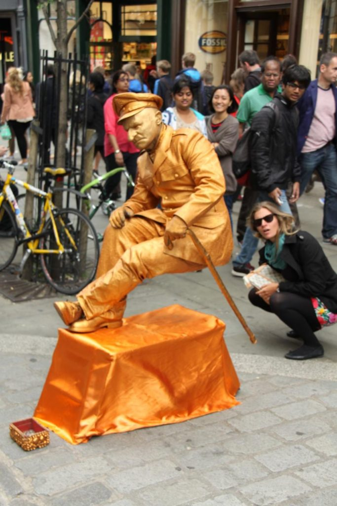 families amazed at an incredible street entertainer at covent garden