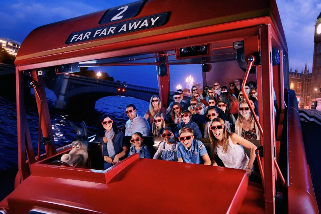 families riding the magical flying bus while on a quest at shrek's adventure london
