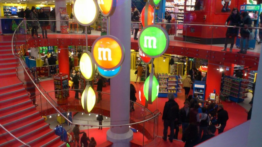 families shopping around m&m's world, leicester square in london