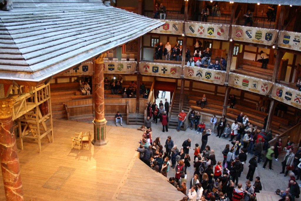 families waiting for a performance at shakespeare's globe theatre