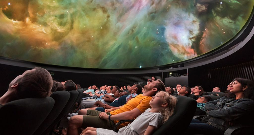 families watching and experiencing amazing planetarium shows