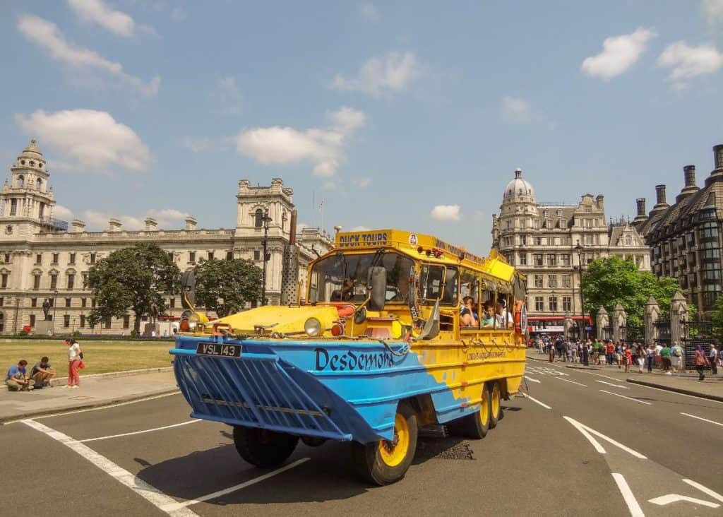 kids riding the yellow amphibious world war II vehicle, london duck tours