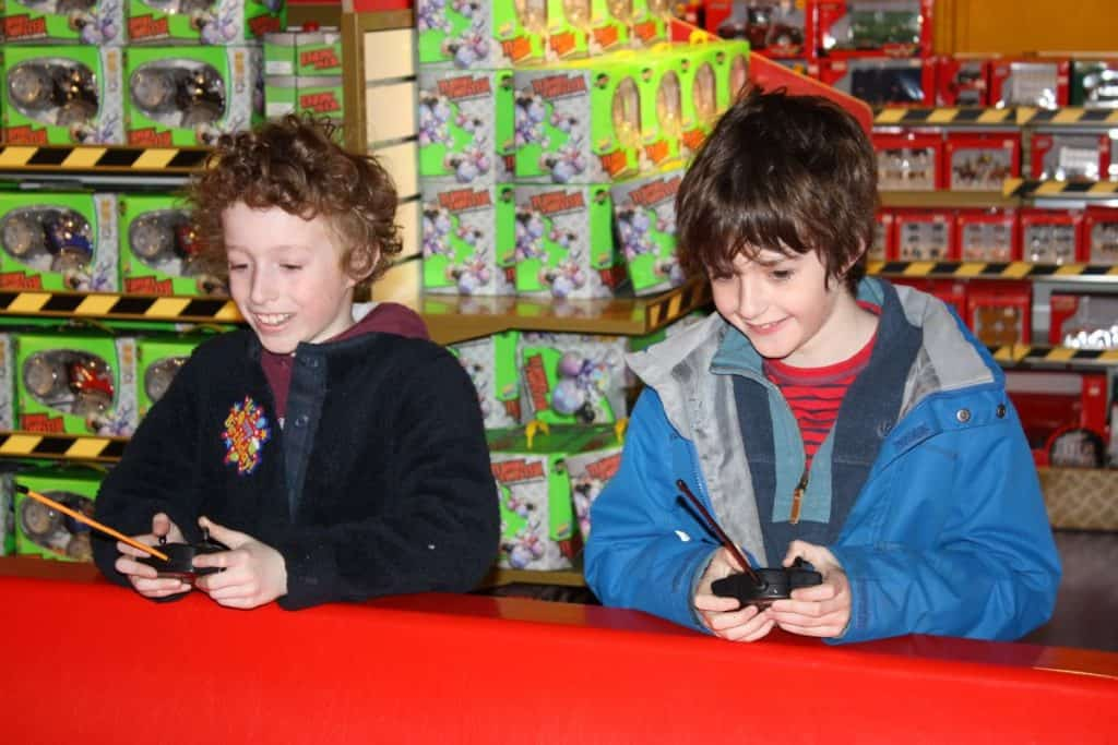 kids trying some toys inside hamleys
