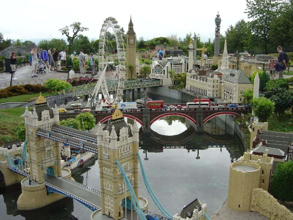 kids with their families looking at london's famous buildings in miniature form at miniland inside legoland windsor
