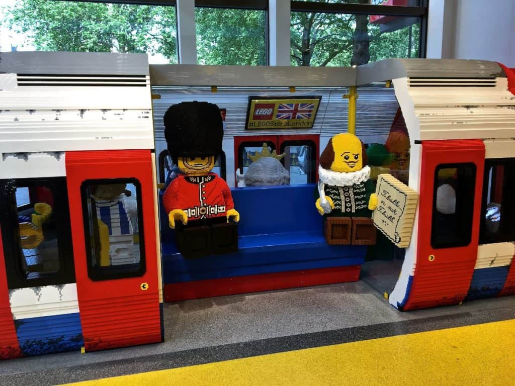 legos that kids can pose and take pictures with at lego store that has life-sized london underground train car