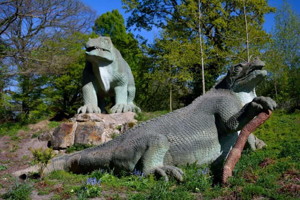 life like dinosaur statues inside crystal palace park