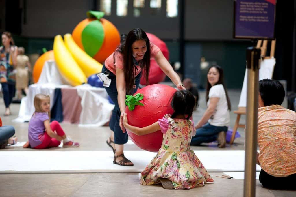 mother and daughter having some artistic fun at the family zone inside the child-friendly tate modern