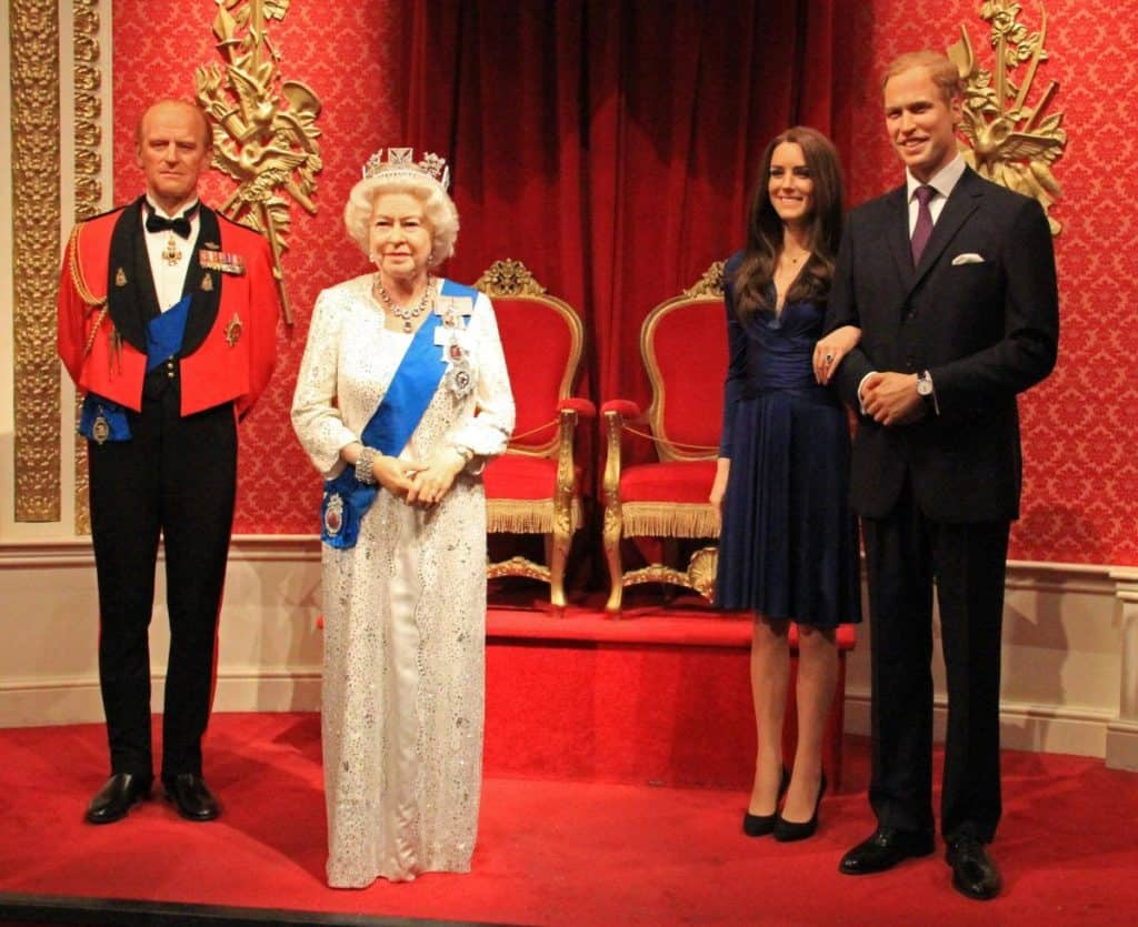 queen elizabeth II and the rest of the royal family's wax versions at family-favorite tourist spot, madame tussauds london museum