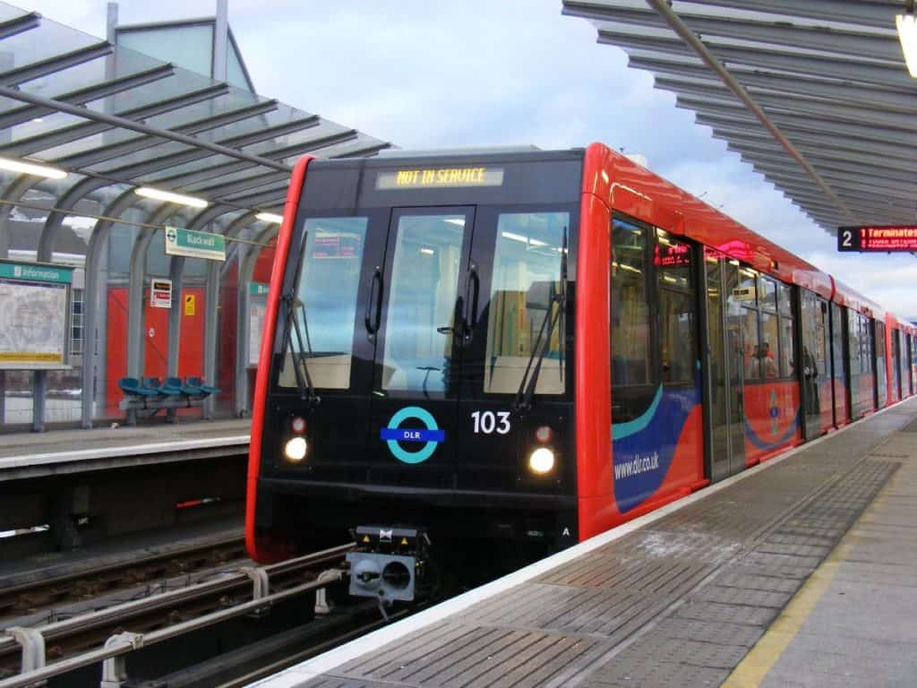 red driverless docklands light railway train in london