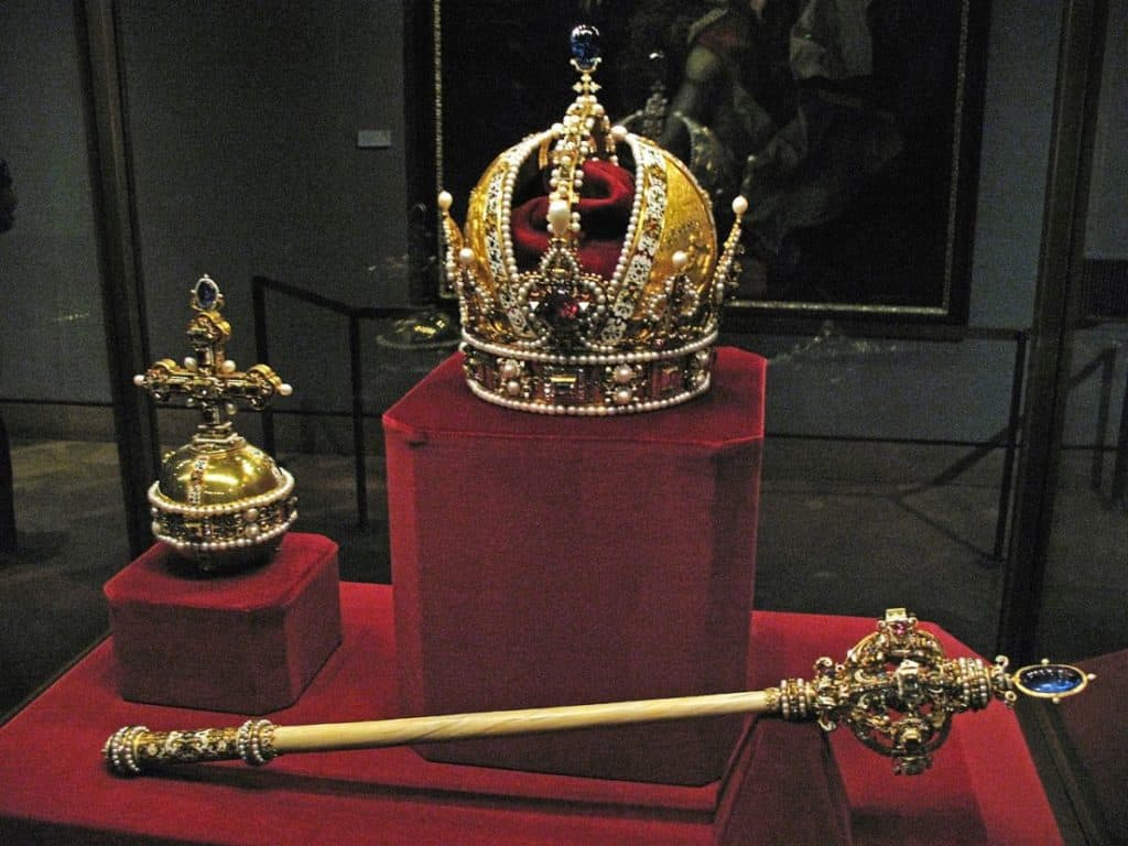 royal crown and ceptre displayed inside the famous tower of london