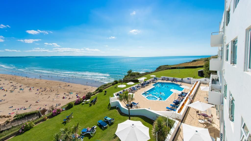 View from the Saunton Sands Hotel overlooking the swimming pool, terrace and the beach