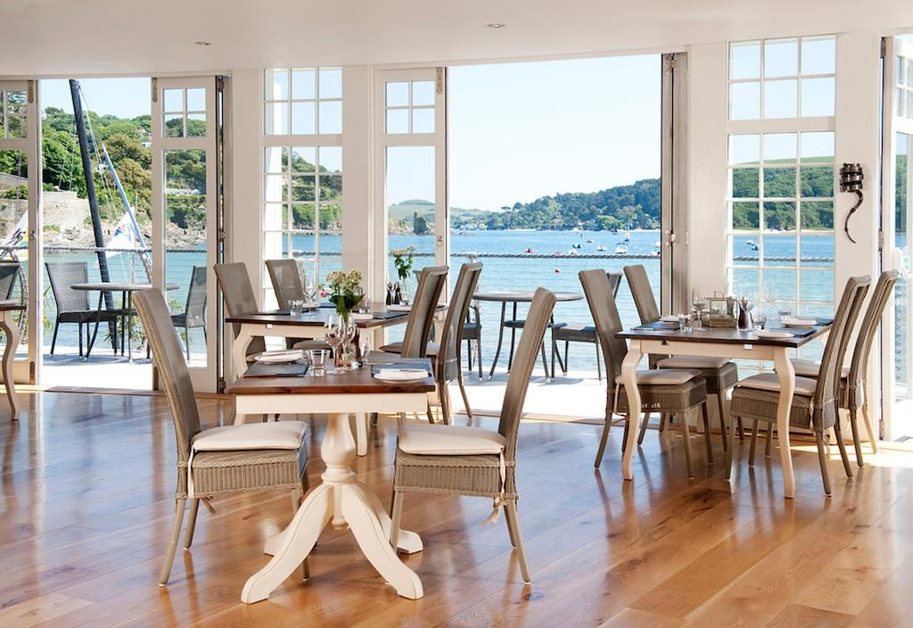 Inside the dining space at South Sands Boutique hotel looking onto waterfront