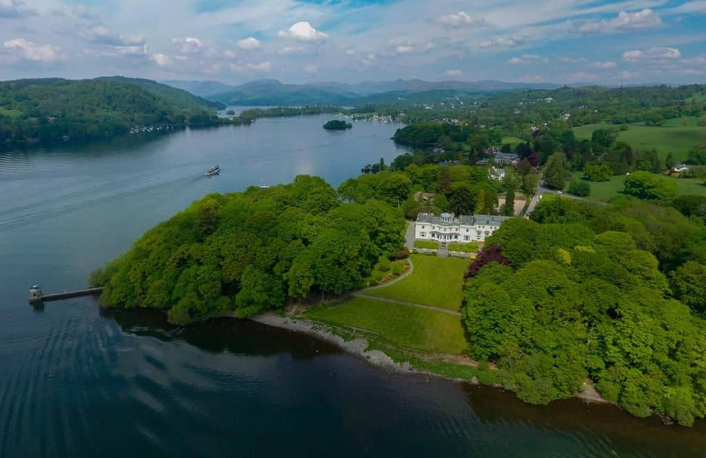 view from above of the storrs hall hotel in bowness on windermere in the lake district