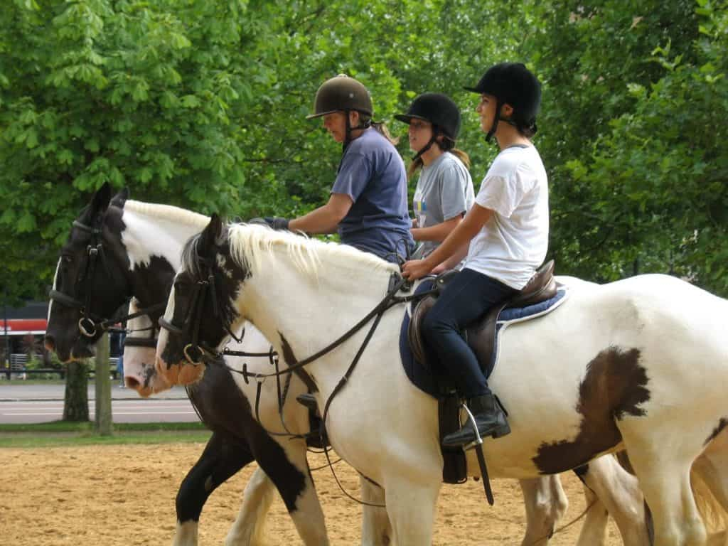 teenagers and kids riding horses like british royalty at hyde park
